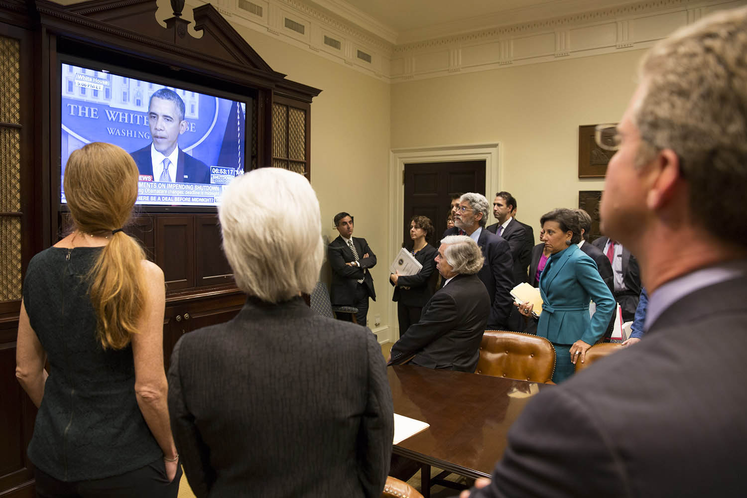 Members of the Cabinet watch as President Obama makes a televised statement on a possible government shutdown