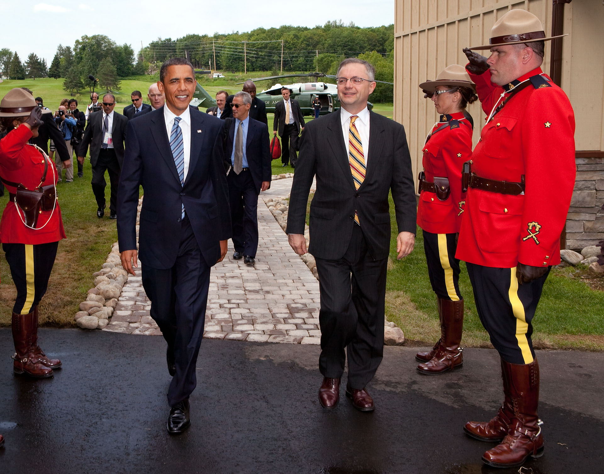 President Barack Obama is Saluted by a Royal Canadian Mounted Police Officers at G8 Summit in Canada