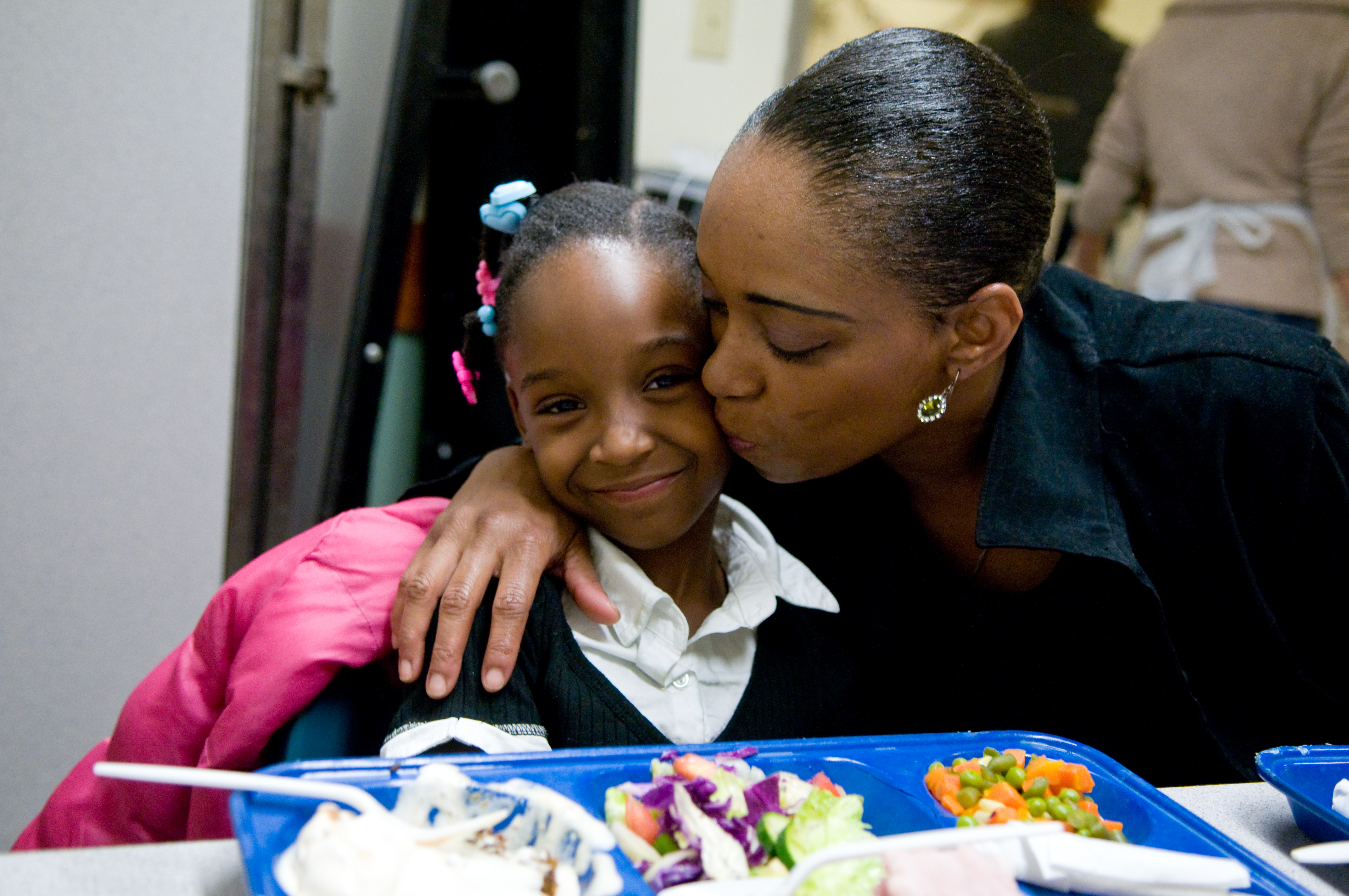 A mother and daughter sharing a meal in GLIDE's Daily Free Meals Program