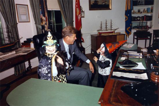 Caroline and John Jr. visit President Kennedy in the Oval Office on Halloween