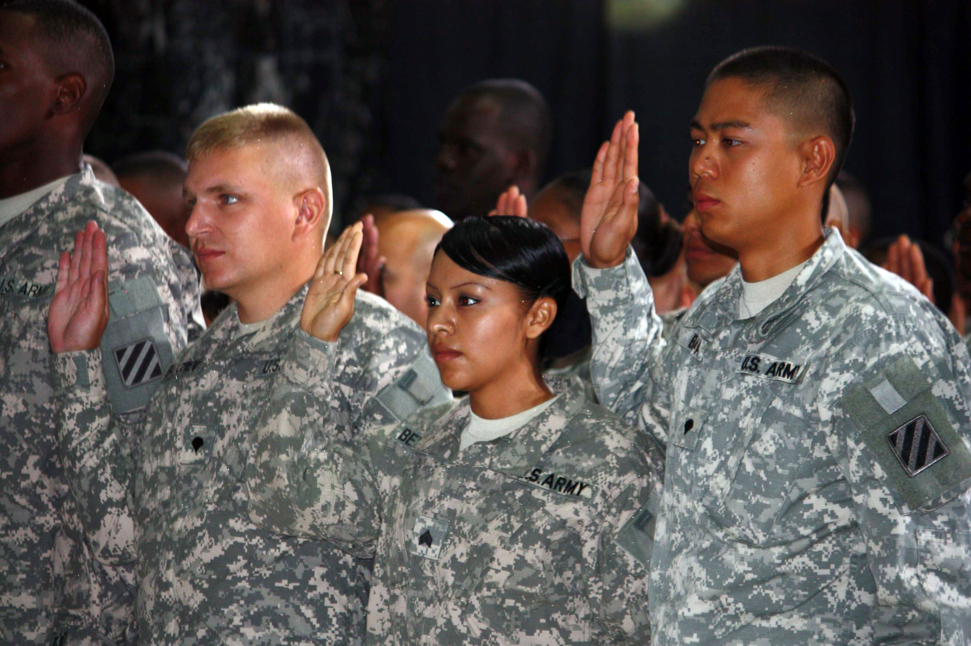 U.S. troops take the citizenship oath during a naturalization ceremony