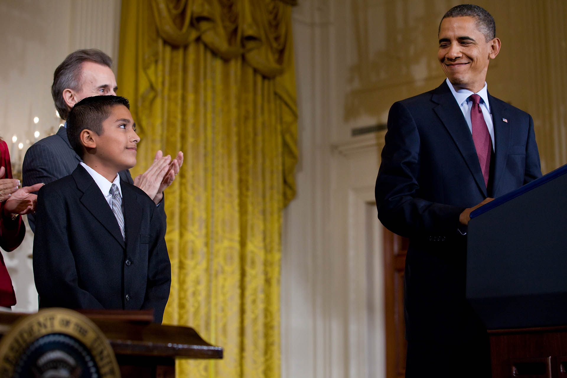 President Barack Obama Looks Over to Javier Garcia of Brownsville, Texas at Signing Ceremony for the Executive Order on Educational Excellence for Hispanic Americans