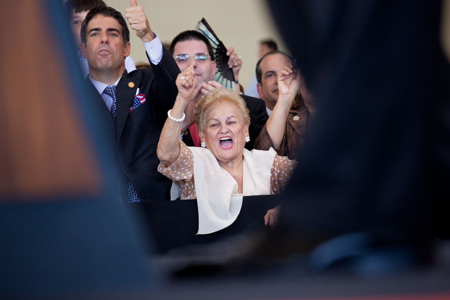 A woman cheers at the arrival ceremony at Luis Munoz Marin