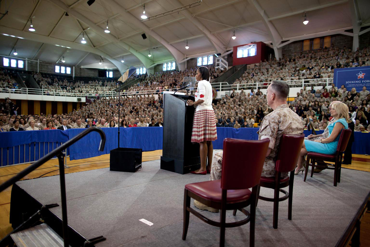 First Lady Michelle Obama delivers remarks to some 3,000 Marines, soldiers, sailors, and military family members at Goettge Memorial Field House at Camp Lejeune, N.C.,
