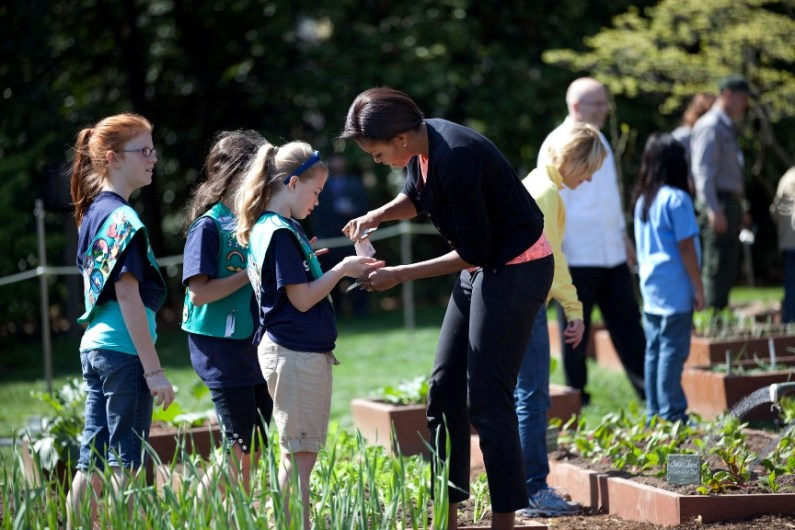 First Lady Michelle Obama gives seeds to girls from Girl Scout Troop 60325
