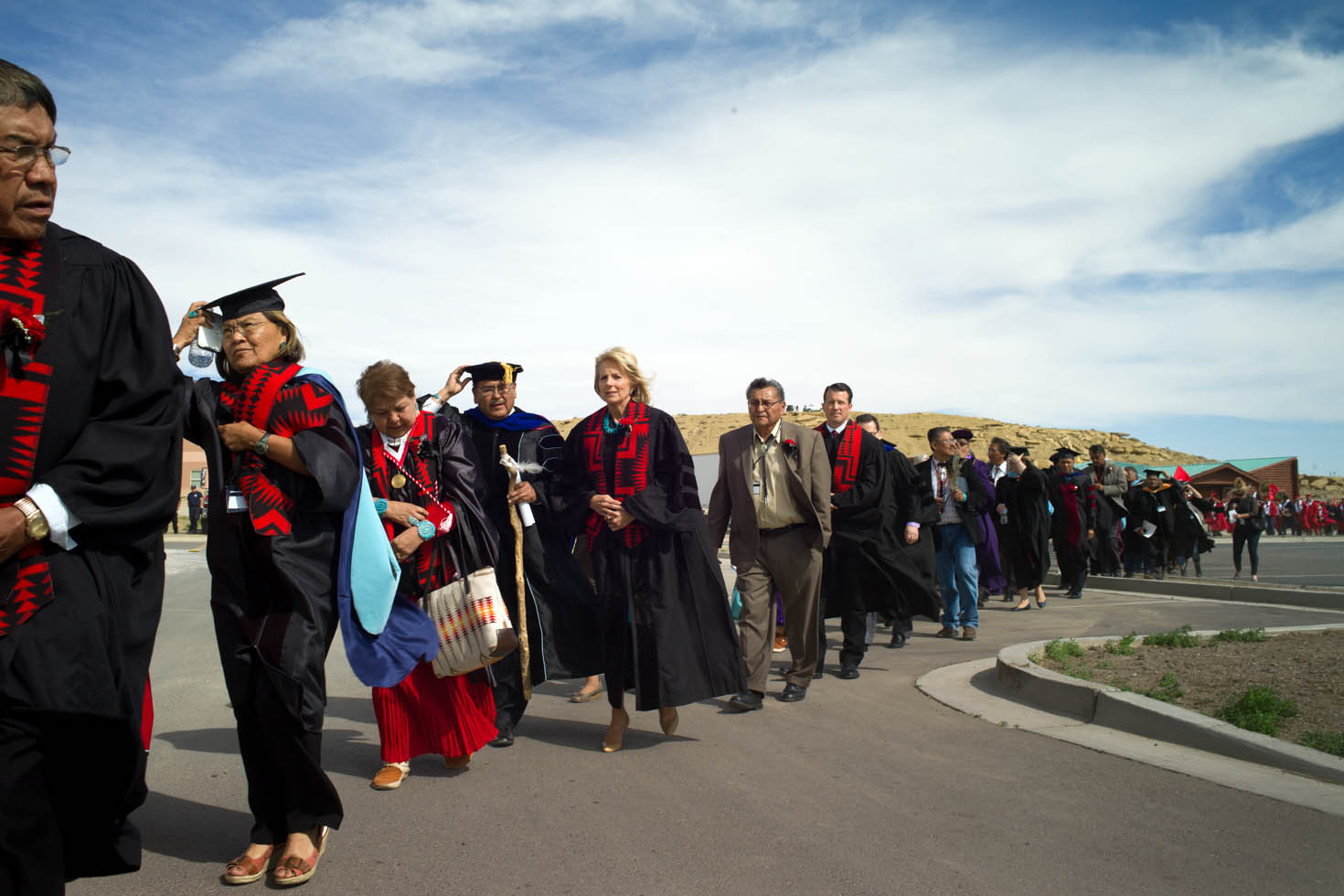 Dr. Jill Biden walks with the procession of graduates of the Navajo Technical College Class of 2013