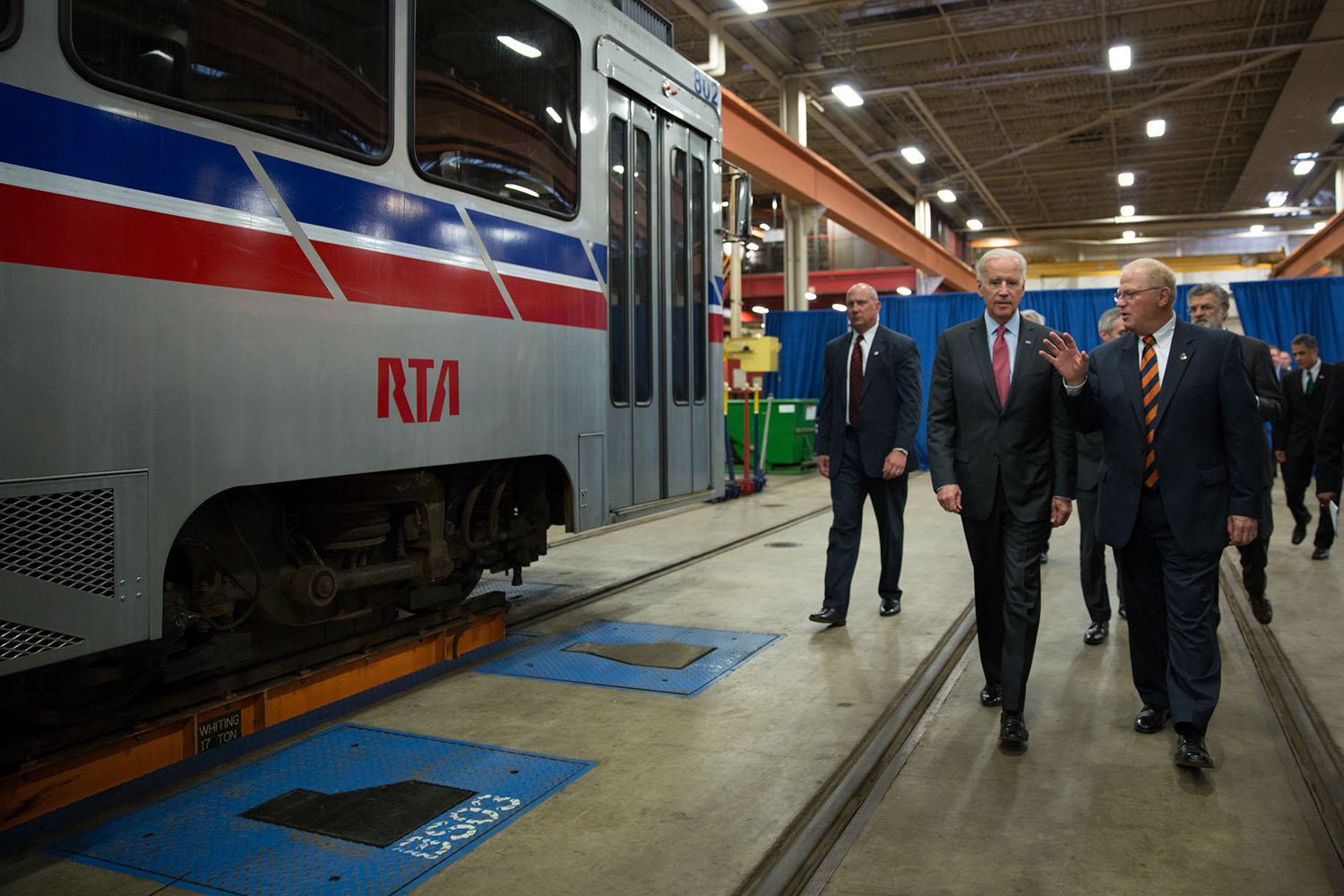 Vice President Joe Biden talks with Joe Calabrese, CEO and General Manager of the Greater Cleveland Regional Transit Authority, at their maintenance facility, in Cleveland, Ohio, May 14, 2014.