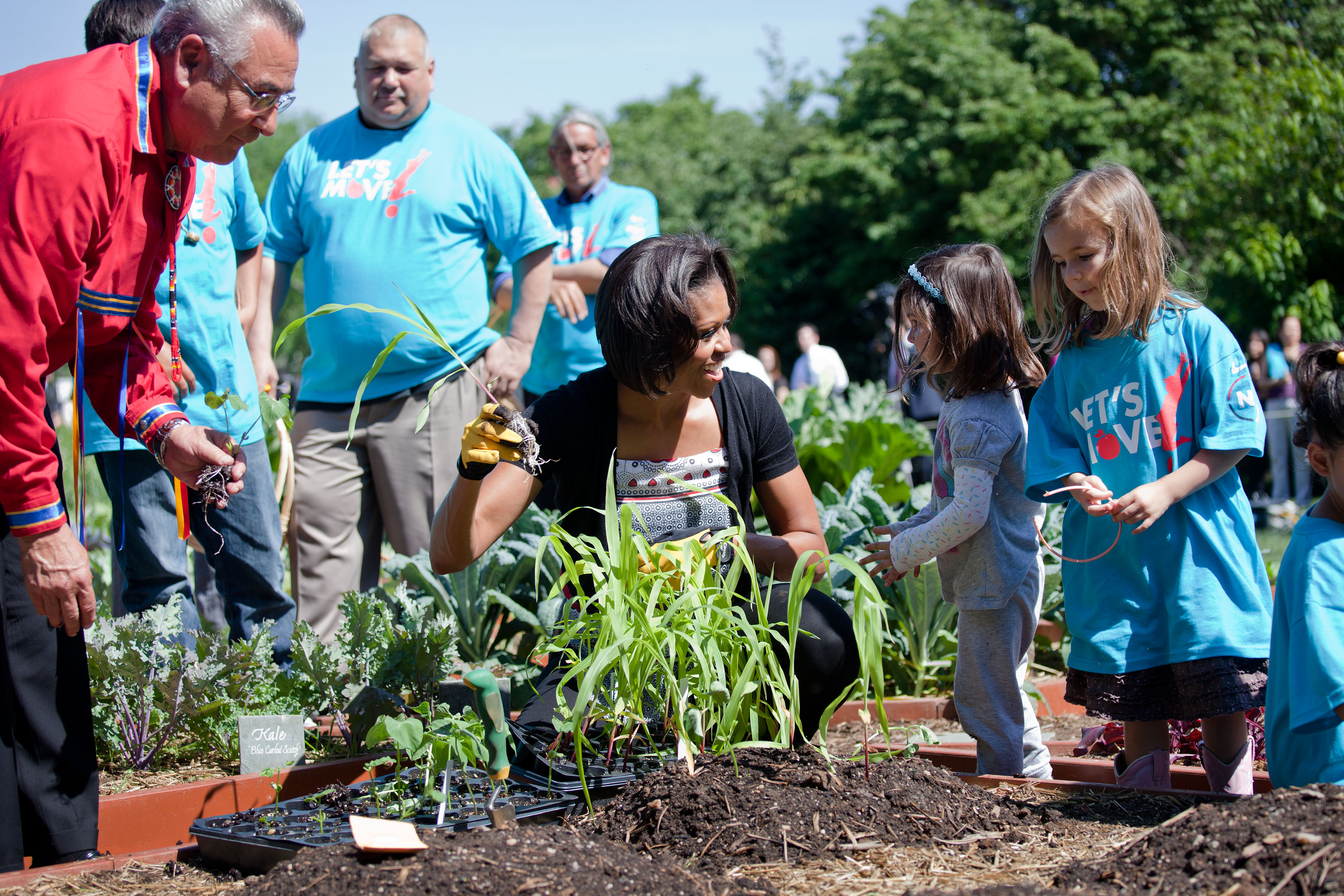 First Lady Plants Garden with Native American Children