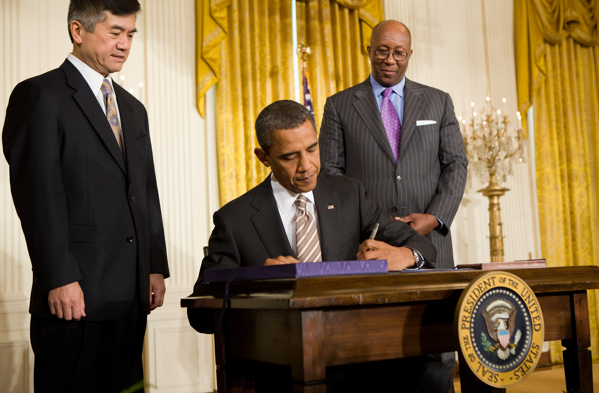 The President Signs the Manufacturing Enhancement Act