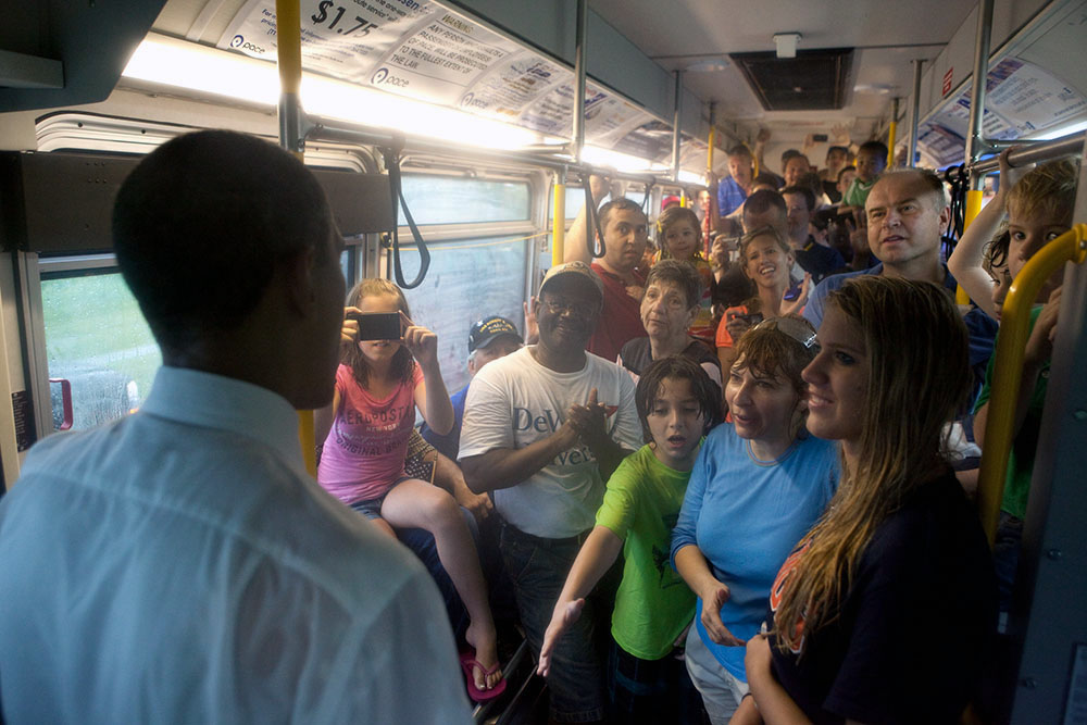 President Obama Talks with Audience Members on a Bus on Memorial Day