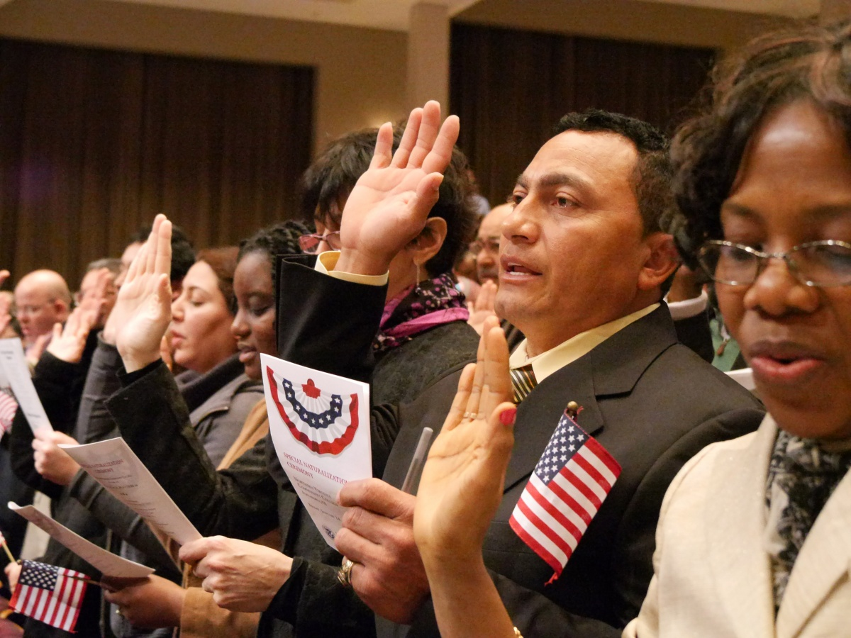 men and women participating in Naturalization ceremony