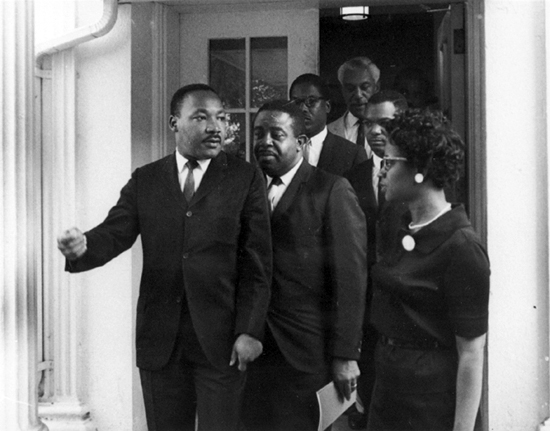 Martin Luther King, Jr. leaves the West Wing after meeting with President Johnson