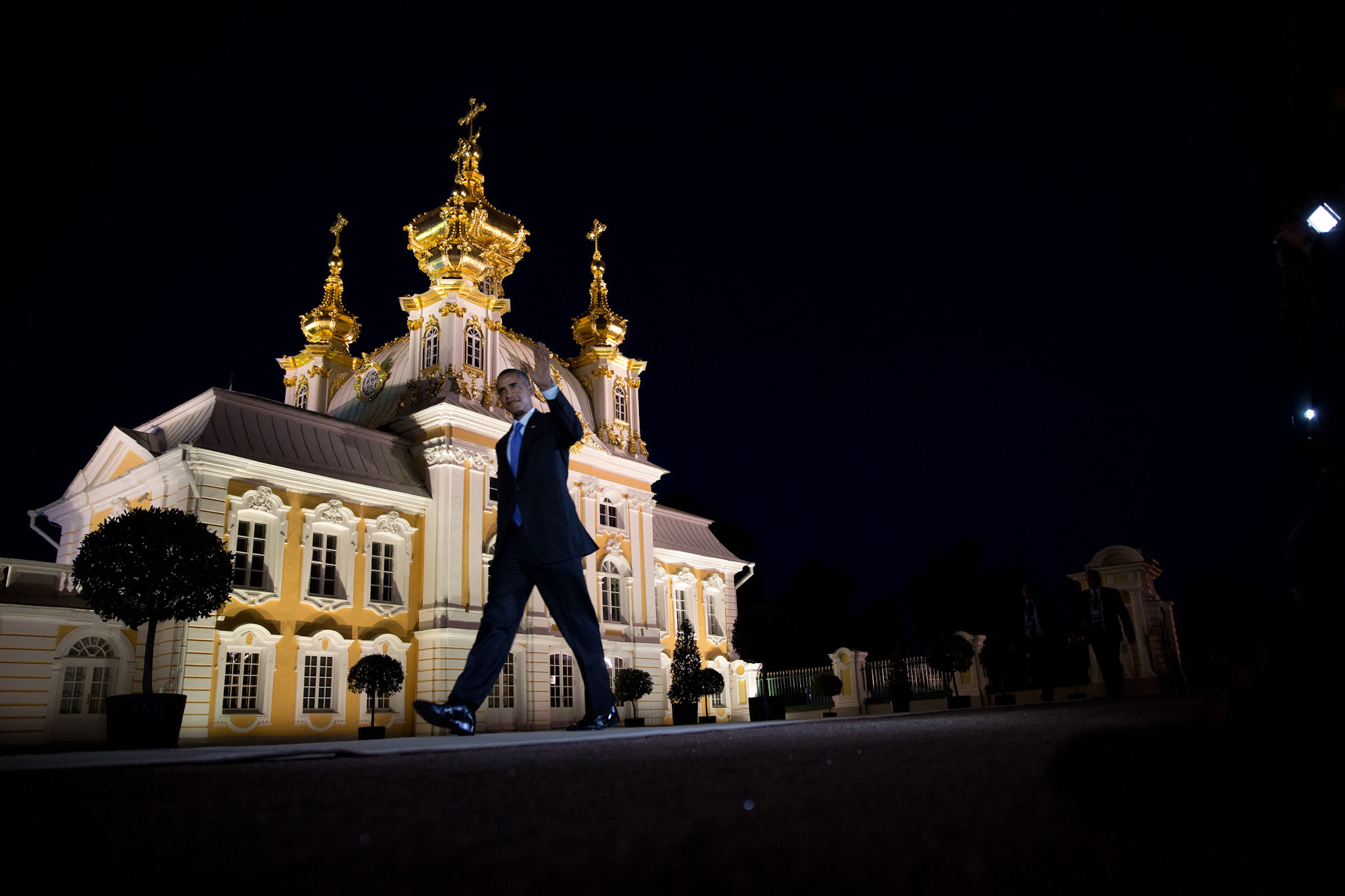 President Barack Obama waves as he walks to the dinner with other G-20 leaders at Peterhof Palace