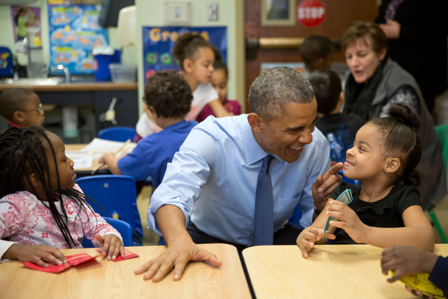 President Obama plays with children at Child Center