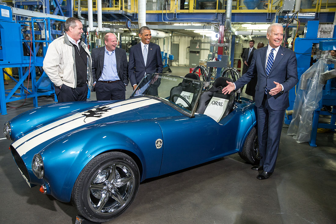 The President and Vice President view a 3D-printed carbon fiber Shelby Cobra car during a tour of Techmer PM