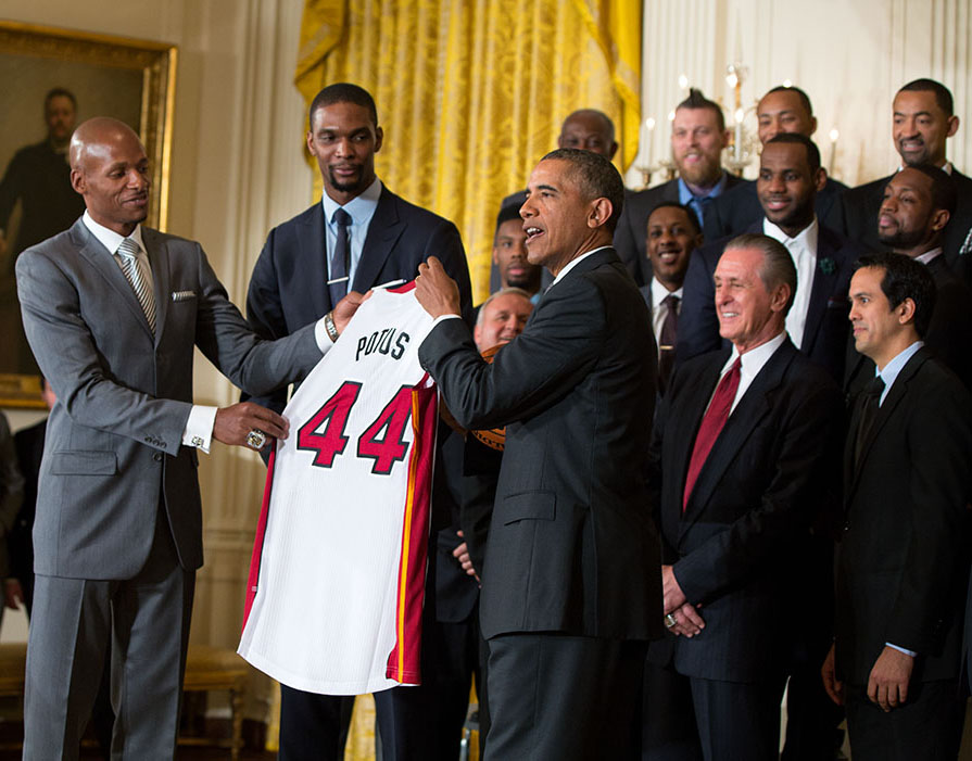 LeBron James, Chris Bosh and Dwyane Wade present President Barack Obama with a basketball and a jersey