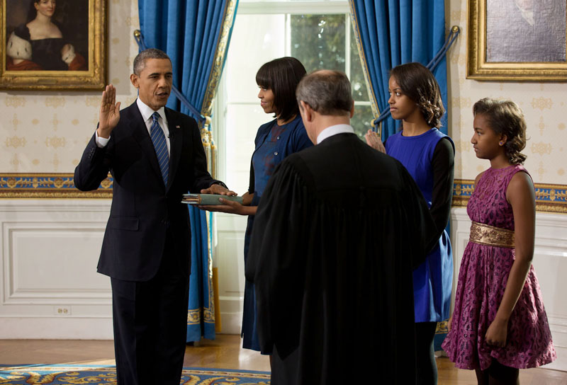 Supreme Court Chief Justice John Roberts administers the oath of office to President Barack Obama