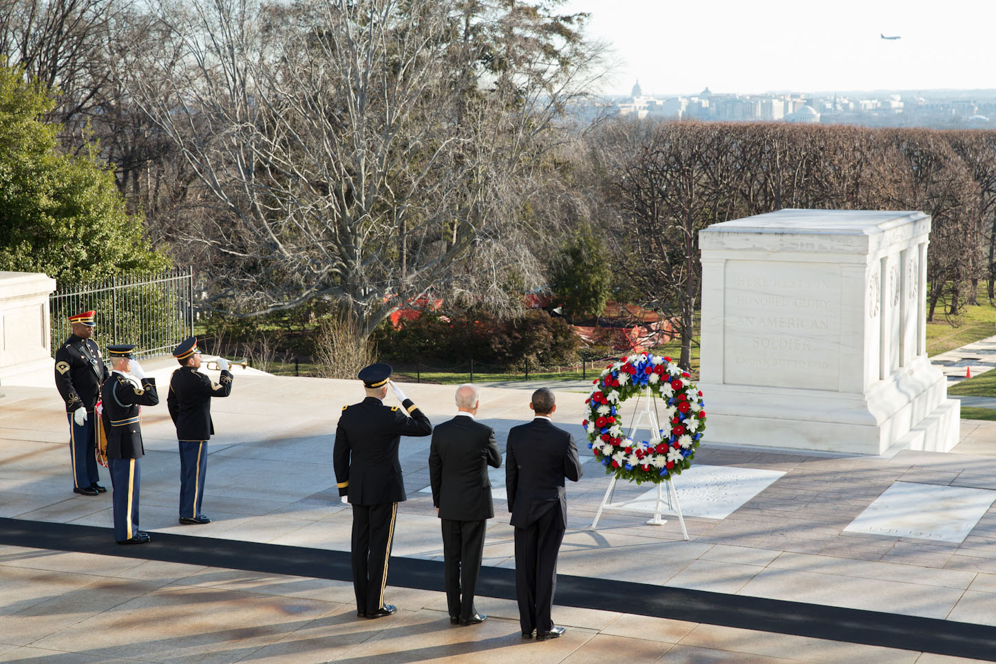 President Barack Obama and Vice President Joe Biden pause during a wreath laying ceremony at the Tomb of the Unknowns