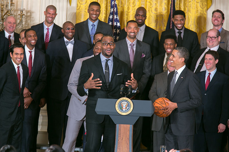 President Obama accepts a basketball from LeBron James of the Miami Heat, Jan. 28, 2013