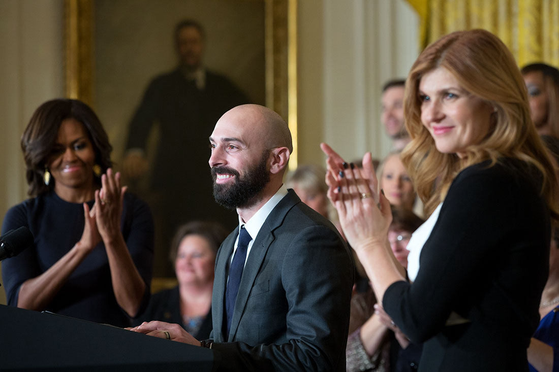 First Lady Michelle Obama and Connie Britton applaud as Counselor of the Year Cory Notestine delivers remarks
