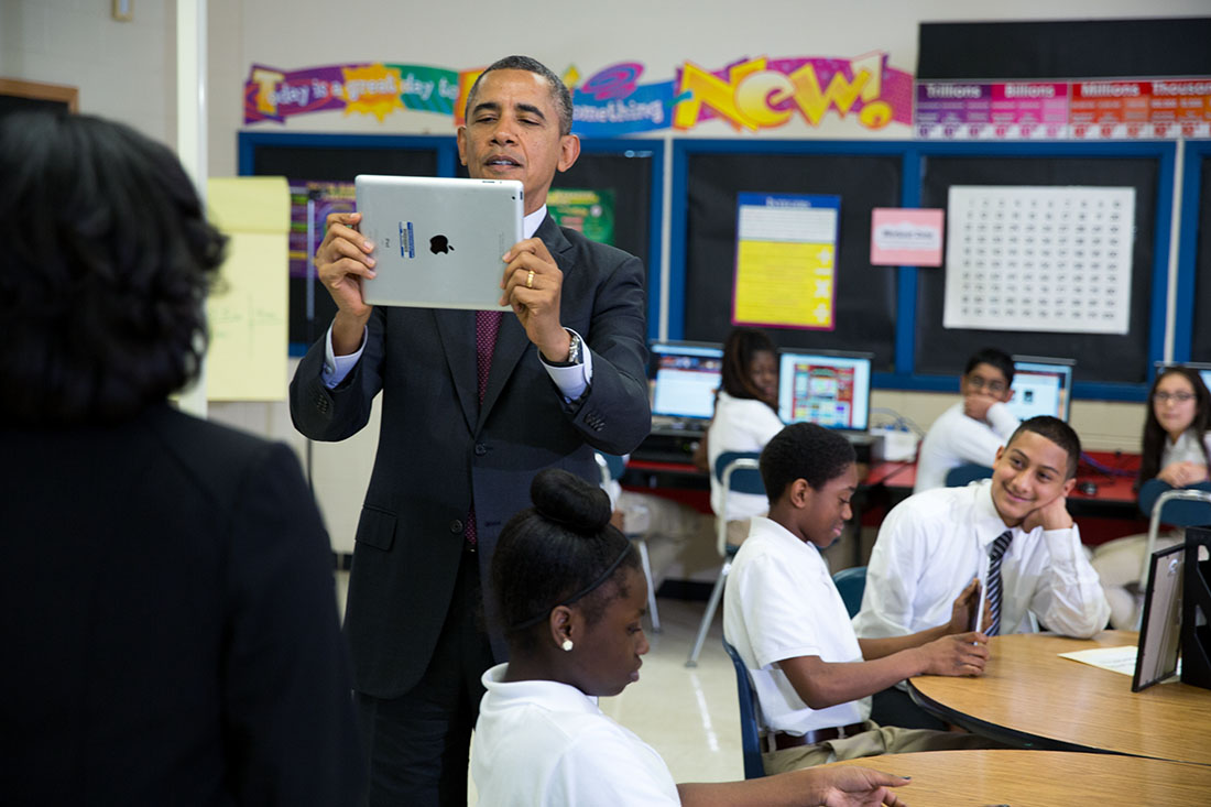 President Barack Obama records video on an iPad