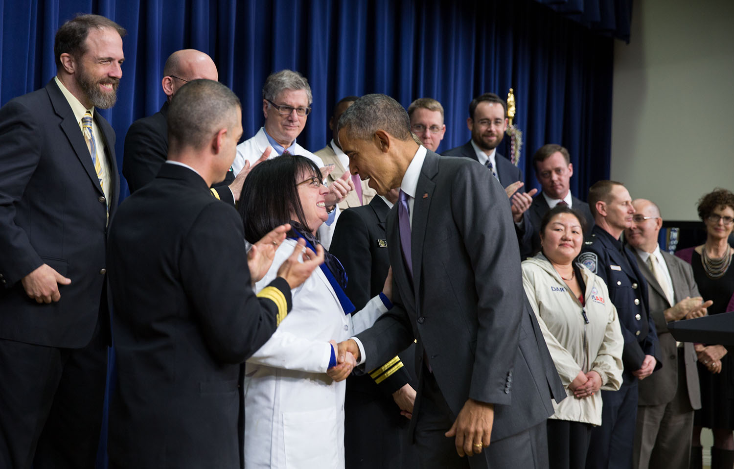 President Obama greets Dr. Nancy Sullivan, a cell biologist with the National Institutes of Health's Vaccine Research Center