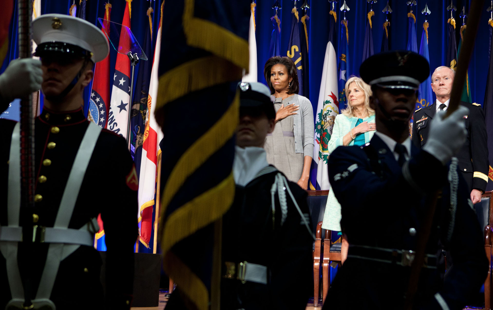 First Lady Michelle Obama And Dr. Jill Biden Stand For The National Anthem