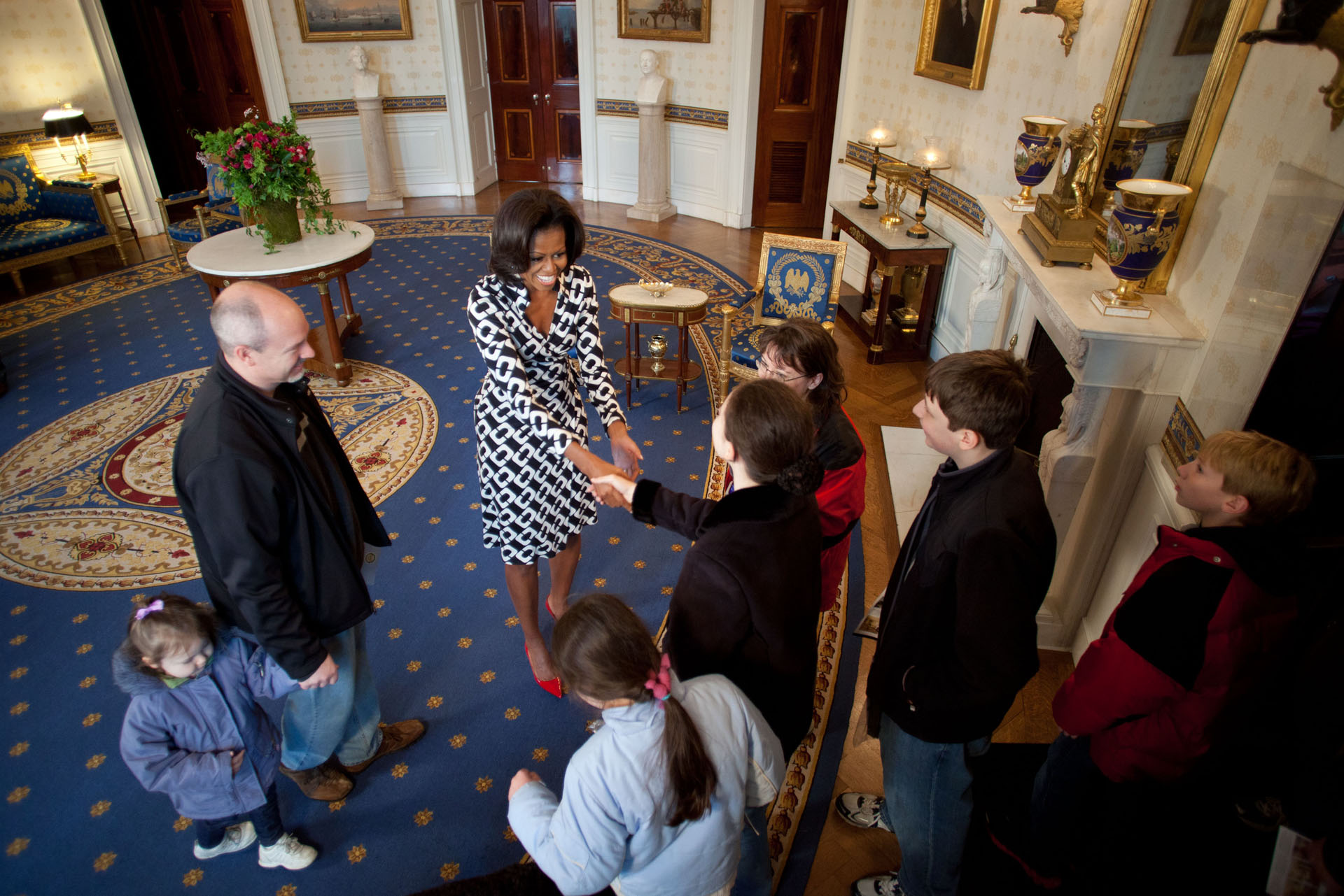 First Lady Michelle Obama Shakes Hands with White House Visitors