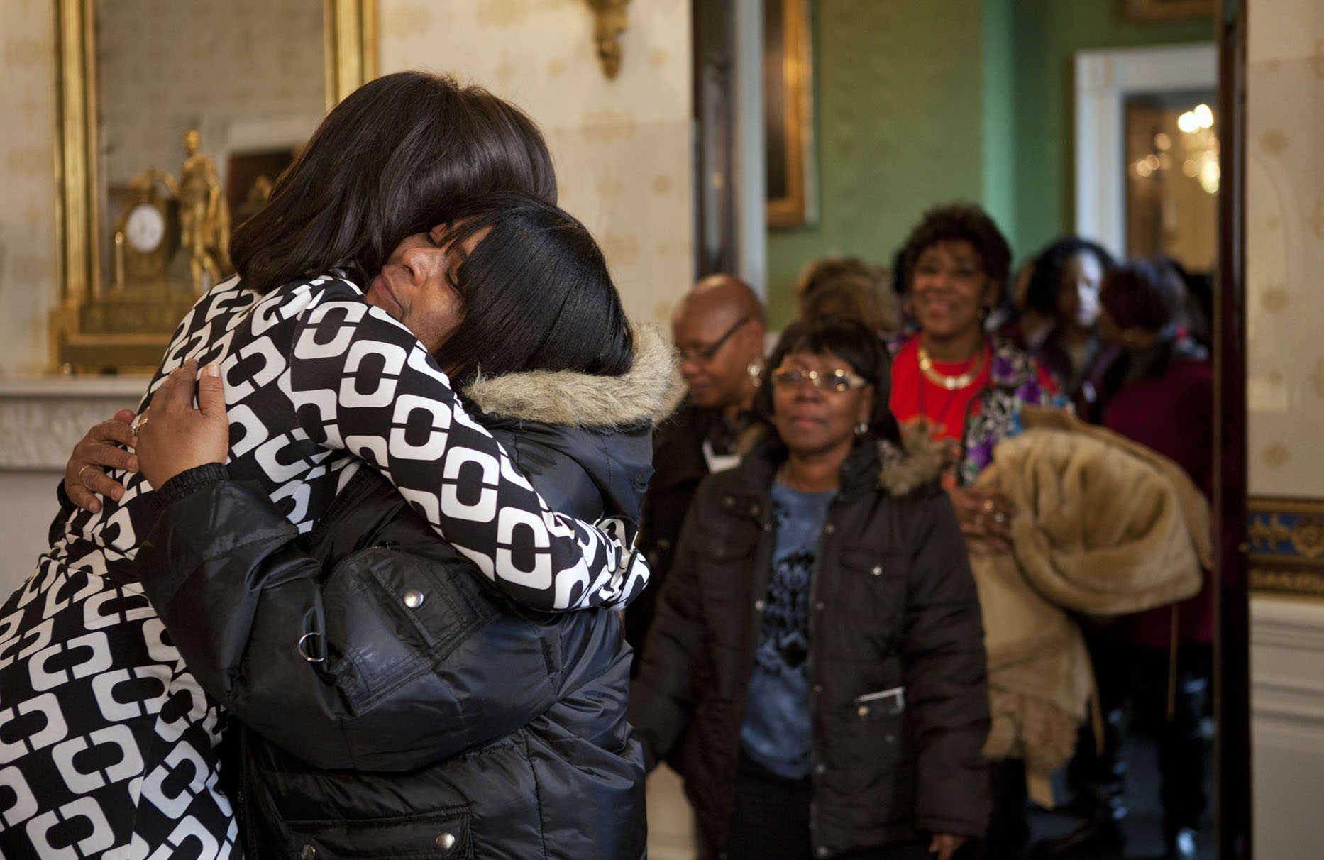 First Lady Michelle Obama Hugs White House Visitor