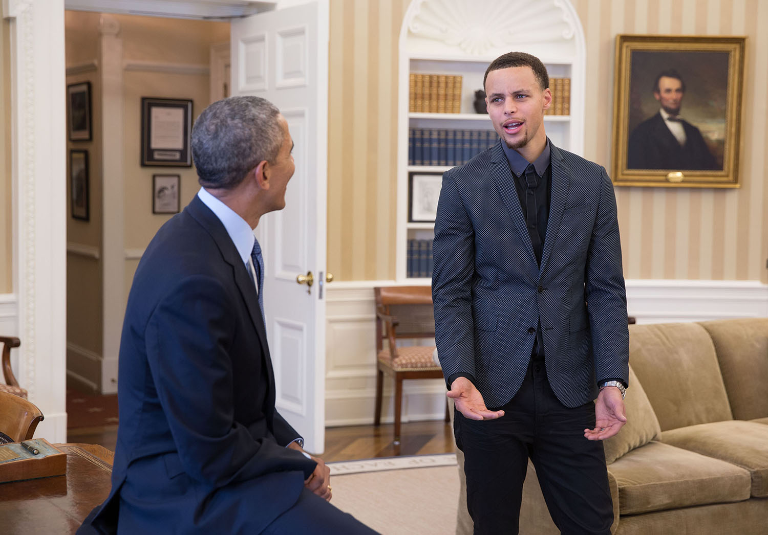 President Obama visits with Golden State Warriors point guard Stephen Curry