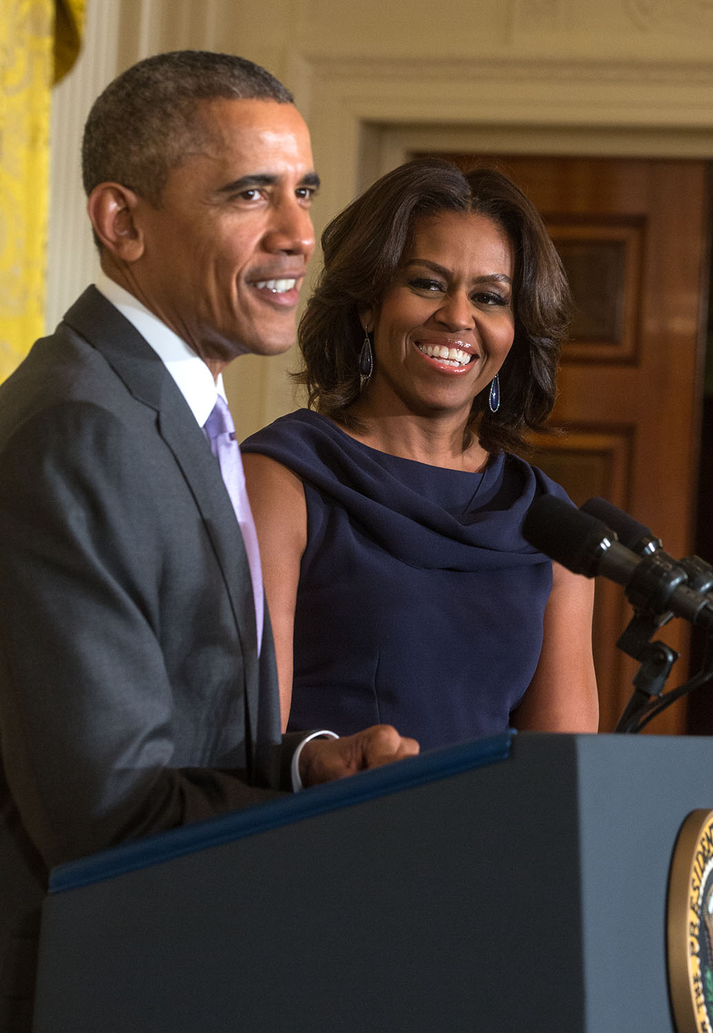 President Obama, with First Lady Michelle Obama, delivers remarks at a
