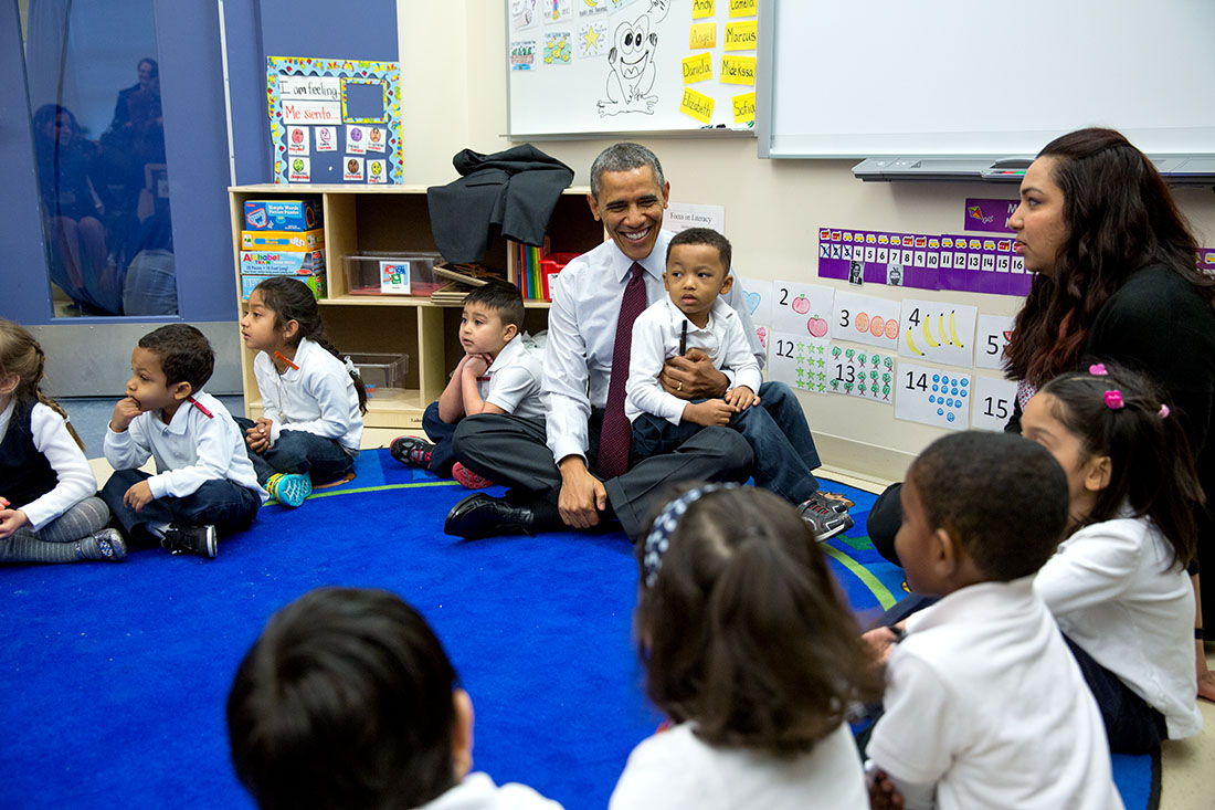 President Barack Obama talks with students during a classroom visit at Powell Elementary School in Washington, D.C