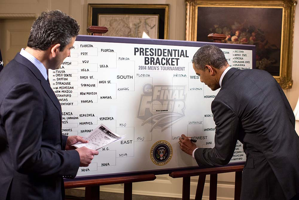 President Barack Obama fills out his 2014 NCAA Division I Men's Basketball Tournament bracket during an ESPN interview with Andy Katz in the Map Room of the White House, March 18, 2014.