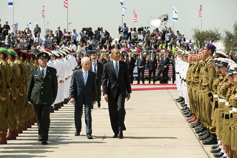 President Obama and Israeli President Peres inspect an honor guard in Tel Aviv, Israel, March 20, 2013