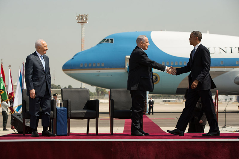 President Obama shakes hands with Israeli Prime Minister Netanyahu during the official arrival ceremony in Tel Aviv, Israel, March 20, 2013