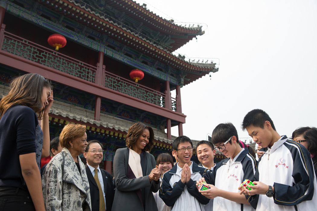 First Lady Michelle Obama, Sasha, Malia and Marian Robinson watch students perform a Rubik's Cube demonstration during their visit the Xi'an City Wall, China