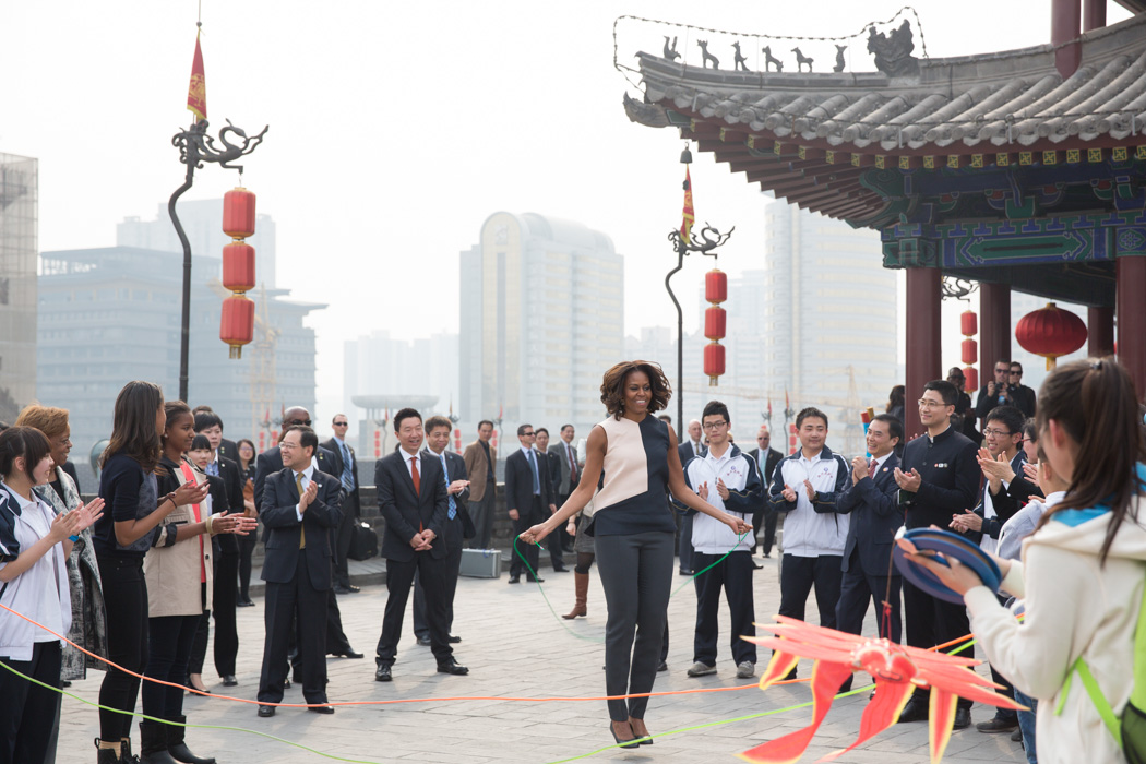 First Lady Michelle Obama jumps rope on her visit to the Xi'an City Wall with Sasha, Malia and Marian Robinson in Xi'an, China
