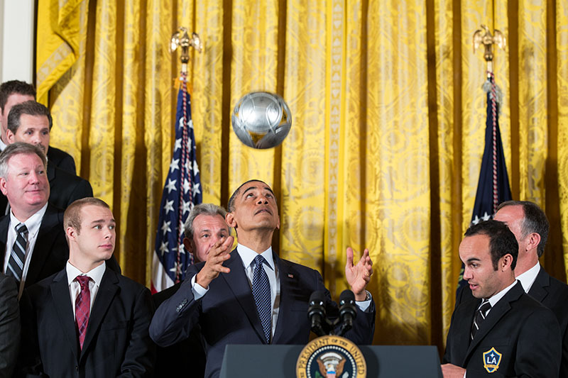 President Obama tosses a soccer ball as he welcomes the LA Kings and the LA Galaxy to the White House, March 26, 2013