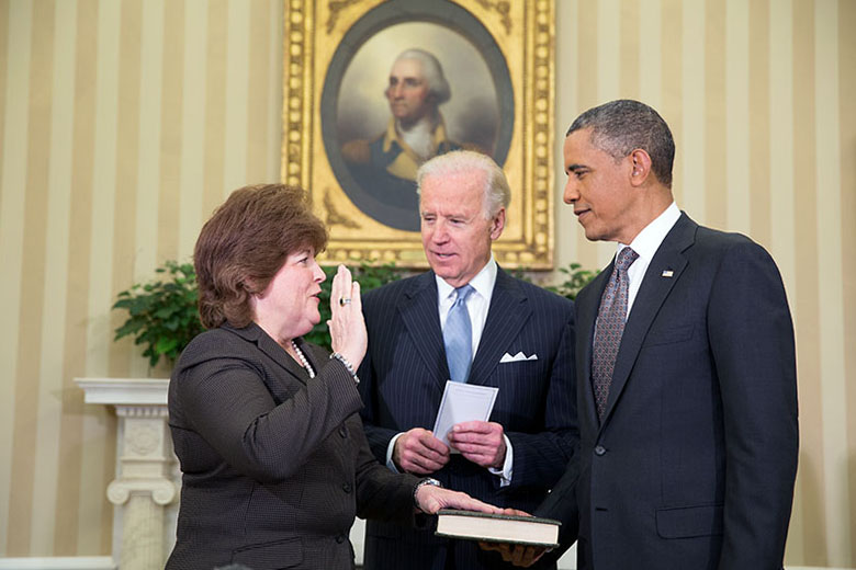 President Obama watches as Vice President Joe Biden administers the oath of office to incoming U.S. Secret Service Director Julia Pierson, March 27, 2013.