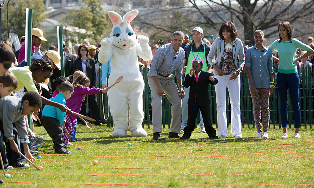 "President Obama, Mrs Obama, Sasha and Malia with ""Kid President"" Robby Novak on the South Lawn for the 2013 White House Easter Egg Roll, April 1, 2013."