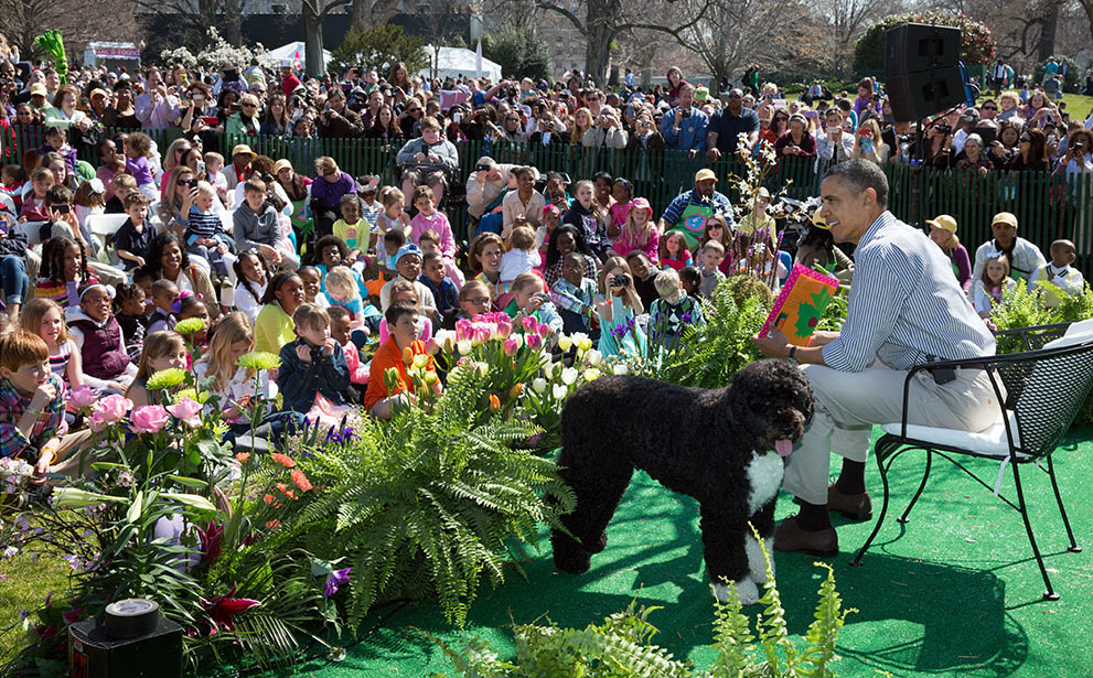 President Barack Obama, with Bo, reads to children during the 2013 Easter Egg Roll, April 1, 2013