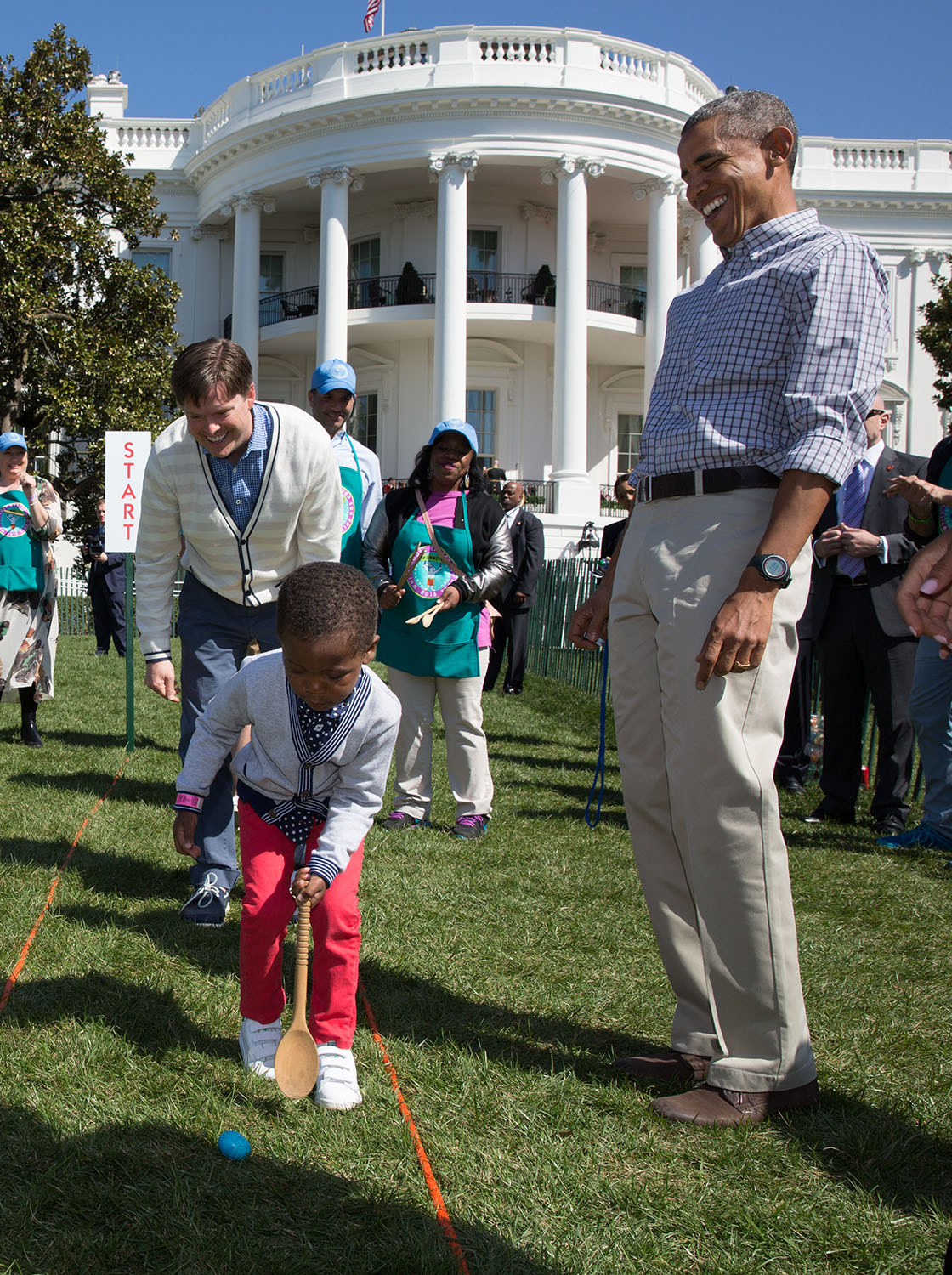 President Barack Obama watches a young boy roll an egg during the annual Easter Egg Roll