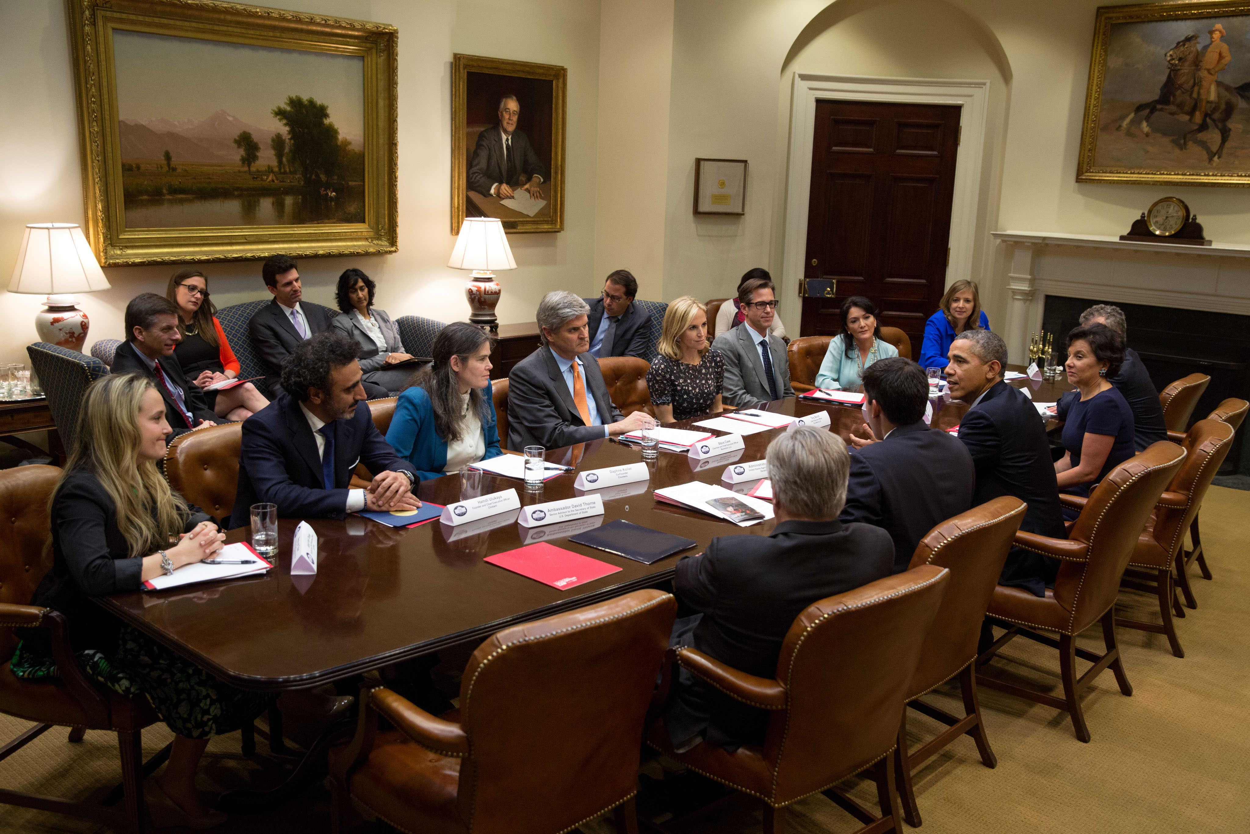 President Barack Obama drops by the first meeting of the Presidential Ambassadors for Global Entrepreneurship, with Commerce Secretary Penny Pritzker, in the Roosevelt Room of the White House