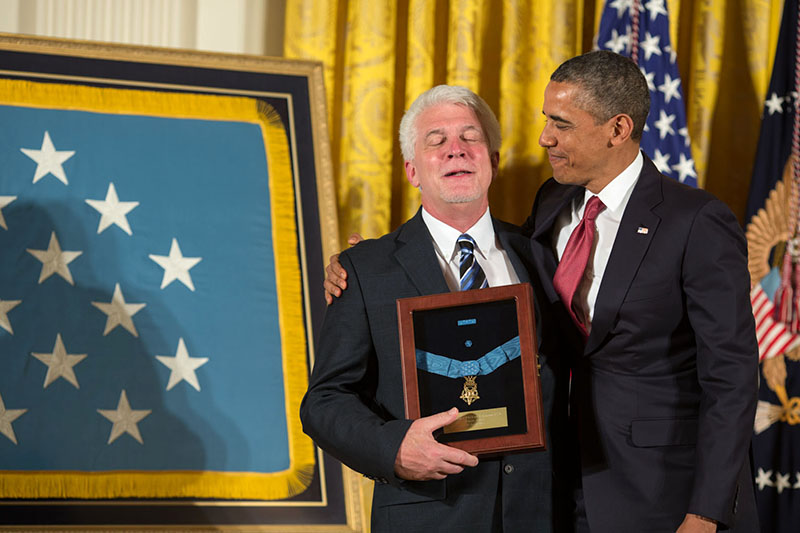 President Obama embraces Ray Kapaun after presenting him with the Medal of Honor awarded to his uncle, Chaplain Emil J. Kapaun, April 11, 2013.