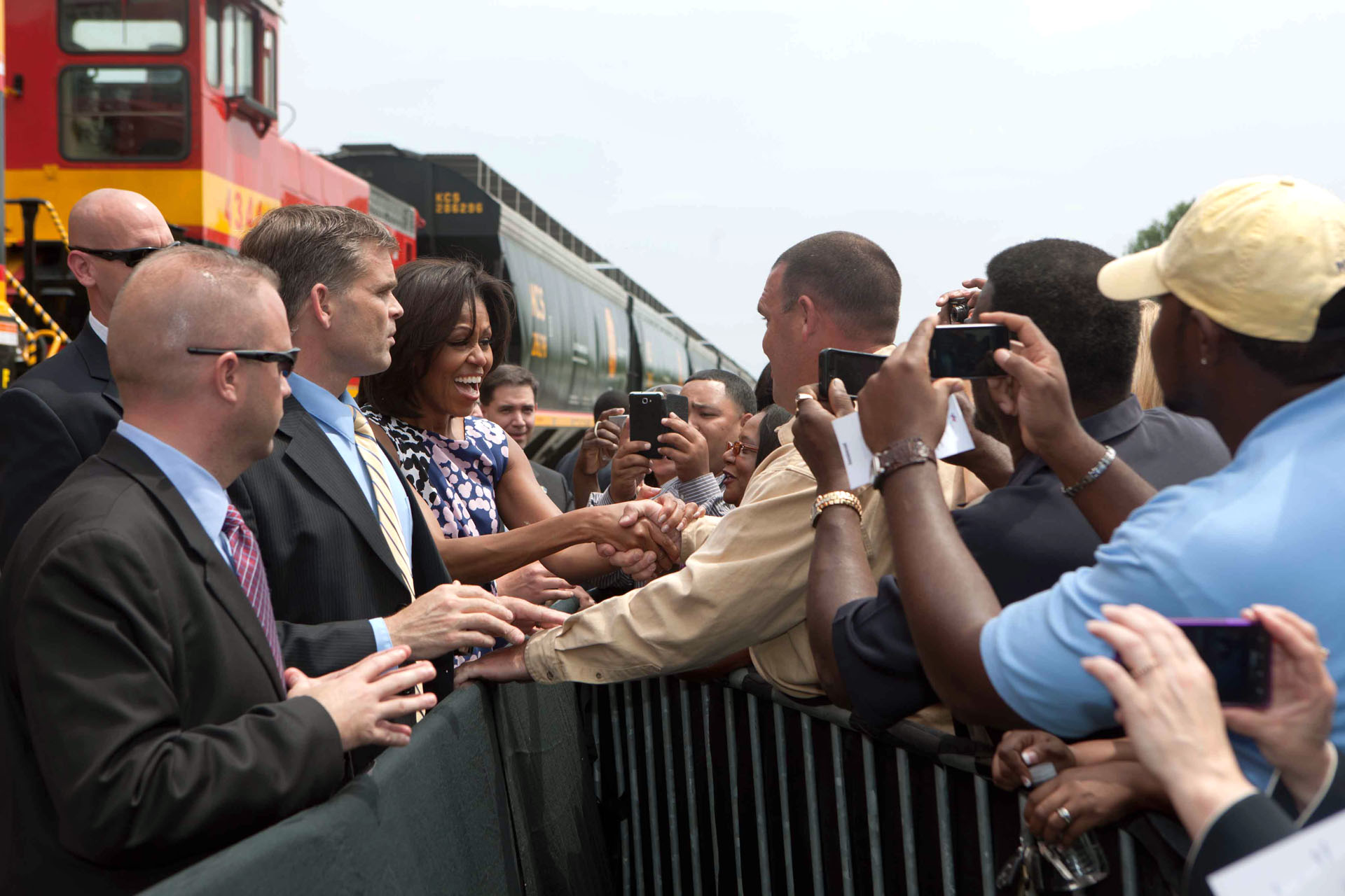 First Lady Michelle Obama greets people in the crowd at Kansas City Southern Railroad
