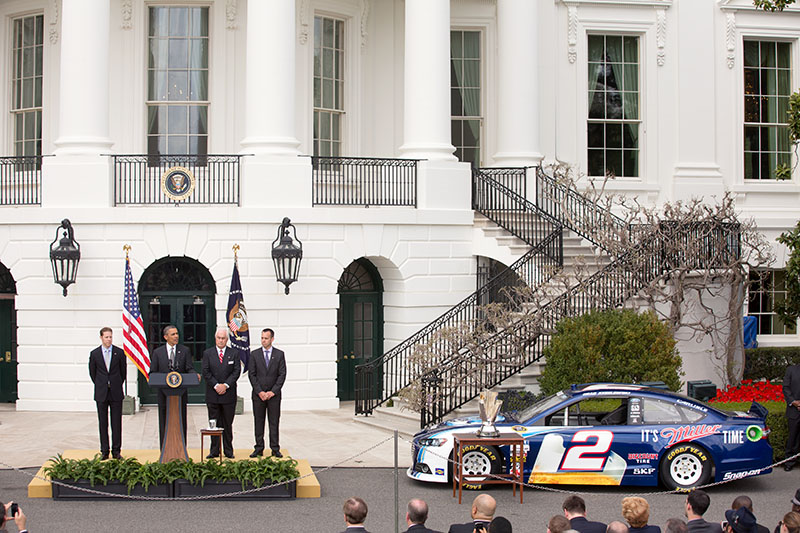 President Barack Obama welcomes Brad Keselowski, left, his crew chief Paul Wolfe, right,  and team owner Roger Penske to the White House