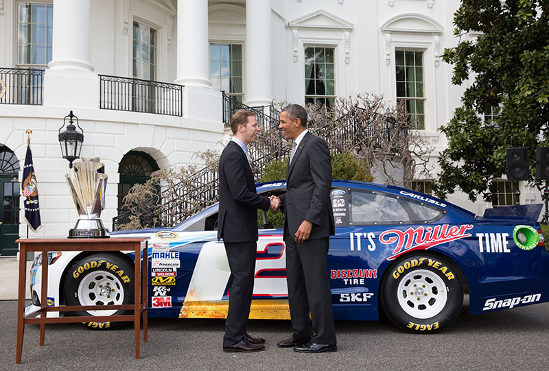 President Barack Obama talks with Brad Keselowski in front of his car during an event celebrating his NASCAR Sprint Cup Series championship