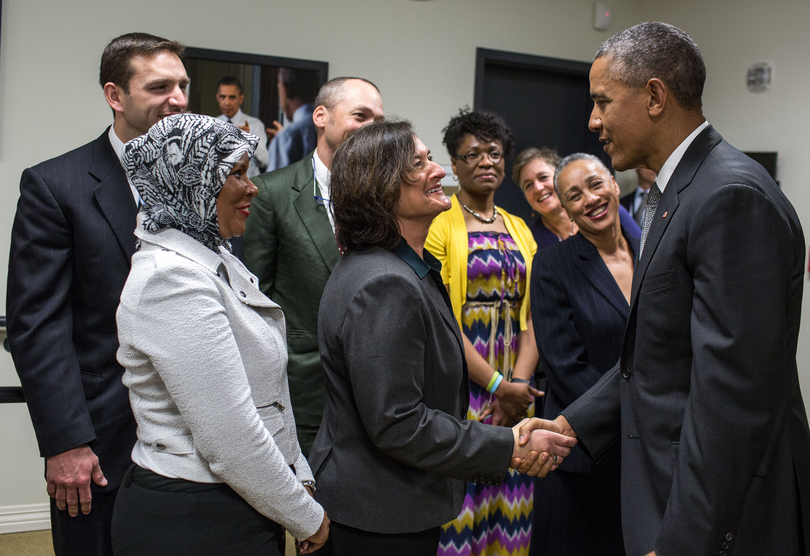 President Obama greets stage participants prior to a Champions of Change event