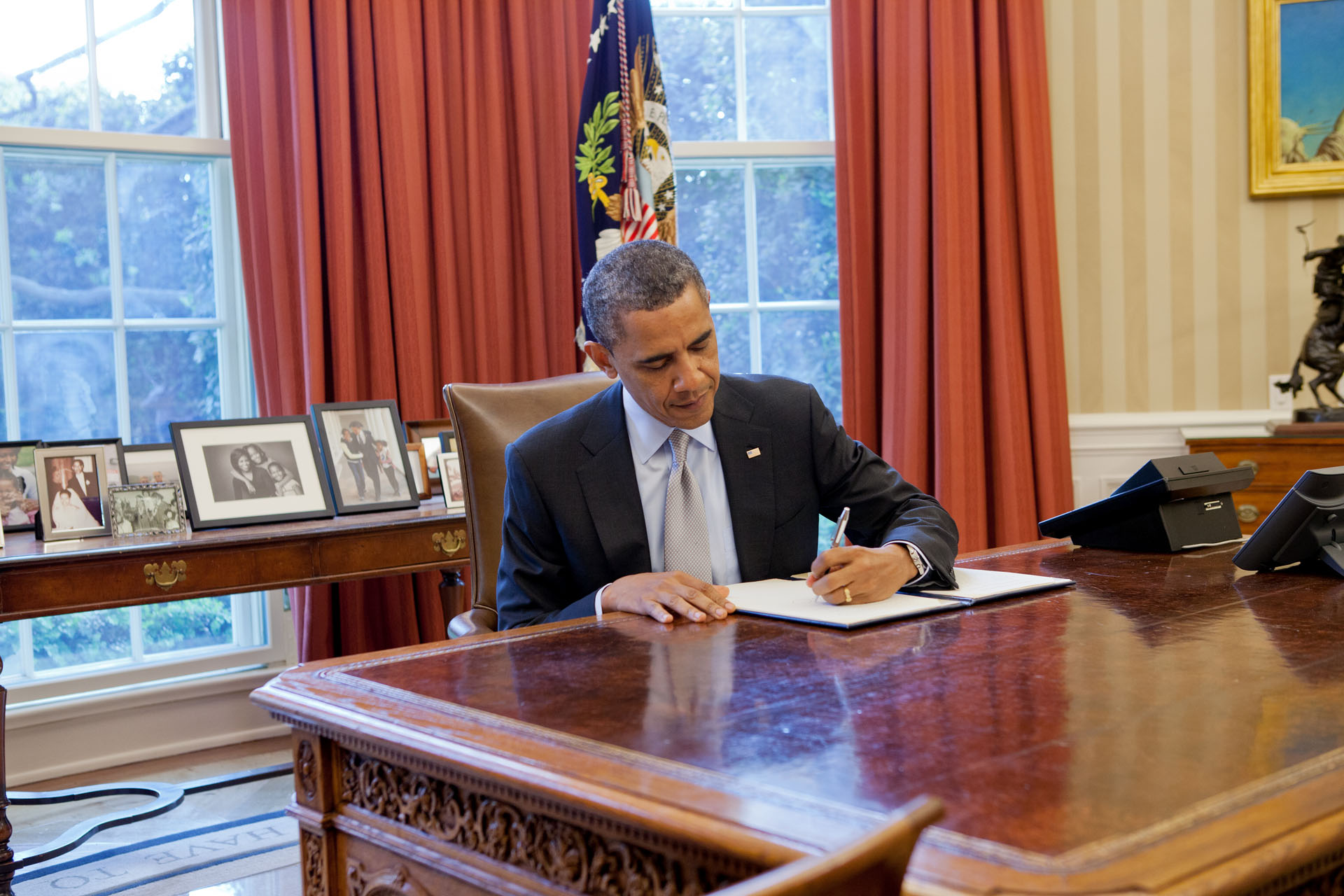 President Barack Obama signs a proclamation regarding the establishment of the Fort Ord National