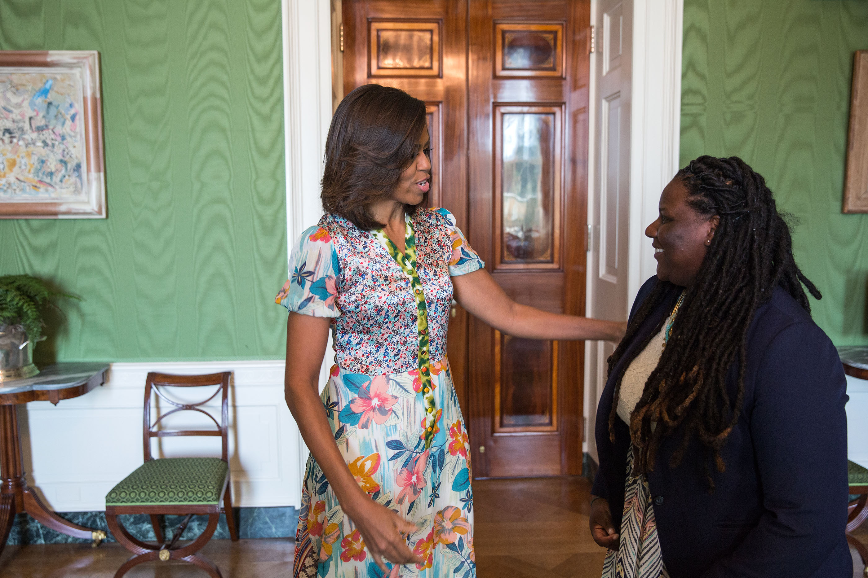 Amnoni Myers is greeted by First Lady Michelle Obama